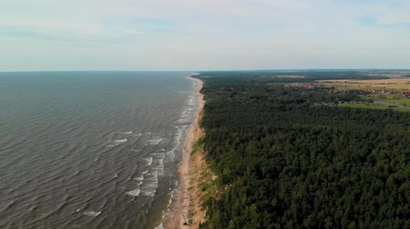 Aerial view of a paraglider flying over the Dutchmans Cap, Lithuania