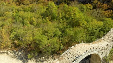 Aerial view of Plakidas arched stone bridge of Zagori region in Northern Greece
