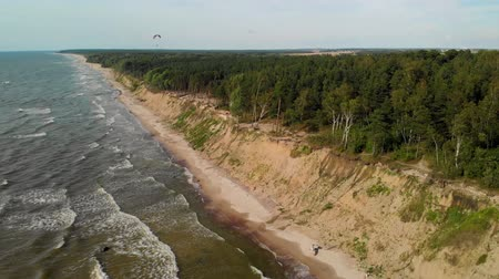 baltık denizi : Aerial view of a paraglider flying over the Dutchmans Cap, Lithuania
