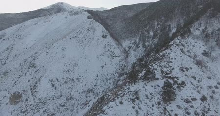 Drone Aerial Flight in the mountains in winter. Beautiful panorama of snow-covered mountains