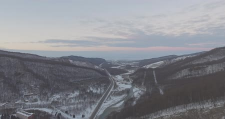 Top view of the mountain road in winter. Drone Aerial Flight in the mountains in winter. Stockvideo