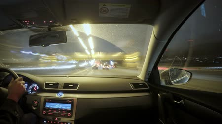 diminishing : Time lapse footage of driving in the night city traffic. View from the interior of the car