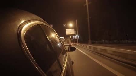 diminishing : Car in the night city traffic on a free wide road Stock Footage