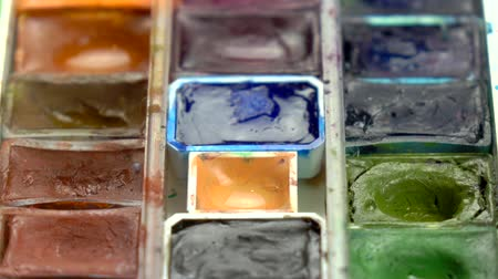 paintbox : Slow-mo footage. Close up set of colorful watercolors. Dolly shot