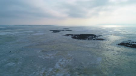 arquipélago : 4k Aerial drone footage. Panorama of frozen lake Stock Footage