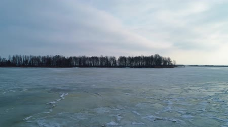 arquipélago : Aeral drone footage. Flight to island on frozen lake