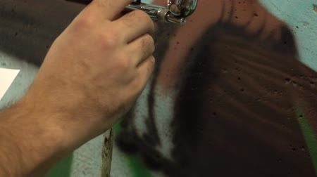 repaint : Slow-mo footage. Artist hand airbrush painting. Close-up