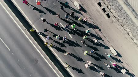 kyiv : 4K Aerial drone fooage. Marathon running on street. Camera rotate. Top view