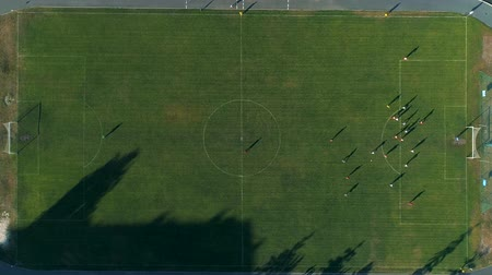 soccer field : Aerial drone footage. Fly over soccer players on field Stock Footage