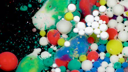 blending : Amazing multicolored bubbles of paint on the oil surface. Paint in oil. Stock Footage