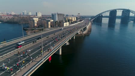 Украина : Marathon running on the bridge. Dolly shot