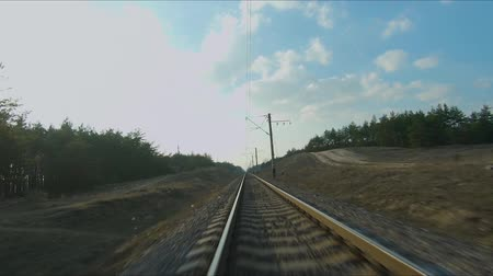 montanhoso : Drone racing view. Fly over railways in forest at sunset. Dynamic shot