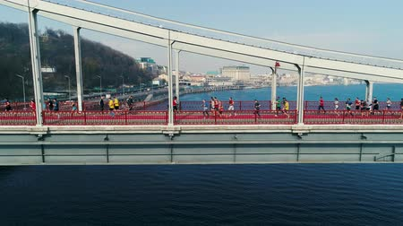 Украина : Marathon running on the footbridge. Dolly shot Стоковые видеозаписи