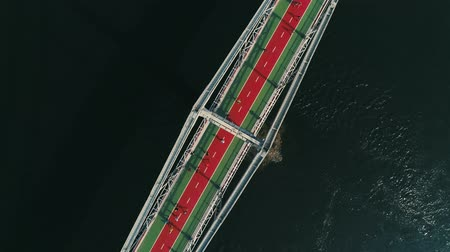 escala : Marathon running on the footbridge. Spin top view shot
