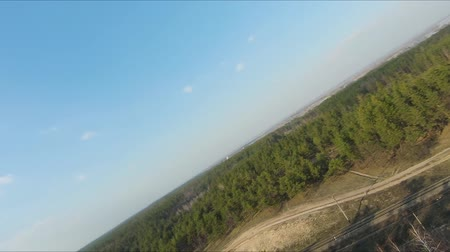 montanhoso : Drone racing view. Fly over forest at sunset. Dynamic shot Stock Footage