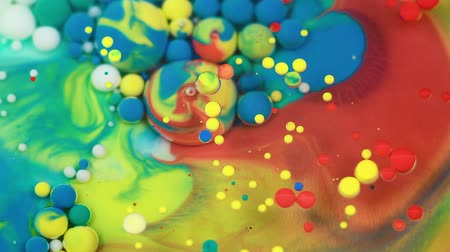 marbling : Abstract multicolored bubbles paint. Slow motion. Top view Stock Footage