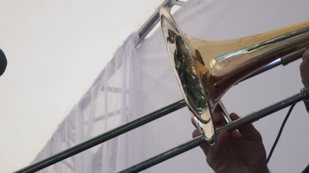 trąbka : Slow motion shot of Musicians is playing on trombone in concert. Wideo