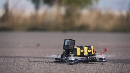 forgórész : FPV racing drone takes off from the asphalt surface