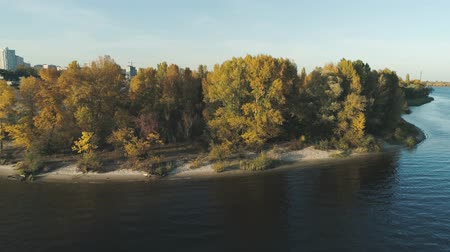 enviroment : Aerial drone footage. Flight over island with view on city and river at autumn season