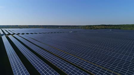 modul : Aerial drone footage. Flight over solar panel farm. Renewable green alternative energy Stock mozgókép