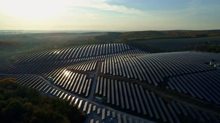epik : Aerial drone footage. Flight over solar panel farm at sunset autumn season. Stok Video
