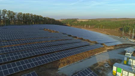 photovoltaic : Aerial drone footage. Flight over solar panel farm at sunset autumn season. Stock Footage