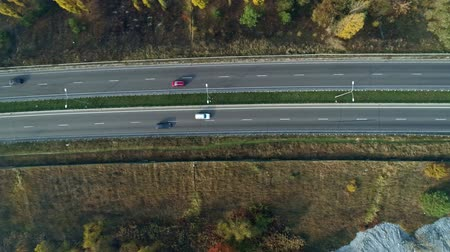 autobahn : Aerial drone footage. Fly over autobahn near forest top view shot. Stock Footage
