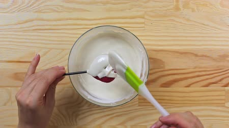 Pouring cake pop in the form of a heart white chocolate, top view