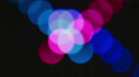 Blue and violet bokeh lights background for party