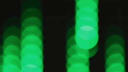 Falling green bokeh lights effect background for party