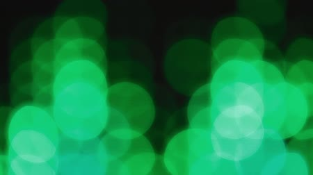 Green bokeh lights effect background for party