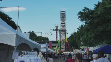 engedmény : a slow motion shot of carnival rides and a crowd