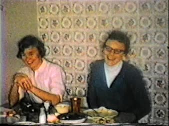 obiad : 8mm vintage archival footage of girls at a dinner table laughing during christmas time