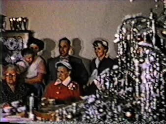 8mm vintage archival footage of guests at a dinner table during christmas time