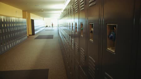 sorok : A wide angle clip of lockers with people in the background