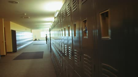 vysoký : A walking and glidecam shot of high school lockers