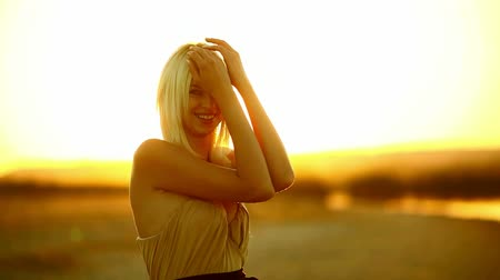 brown dress : Young girl  seductive blonde woman portrait sunset silhouette sexy slow yellow desert sand