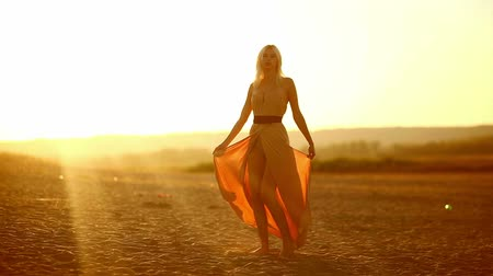 brown dress : sexy young  seductive portrait girl woman on sunset yellow desert sand spinning developing dress