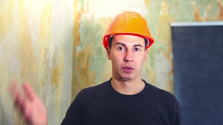 прораб : man helmet  construction worker in a hard hat is talking portrait he speaks talking