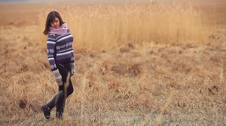 cold : girl woman portrait in sweater scarf and mittens nature autumn dry grass cold