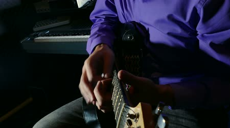 electric : man playing electric guitar recording studio pulls strings