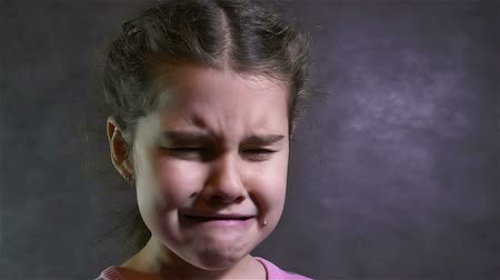 Łzy : girl cries teen tears flow portrait problems under stress slow motion