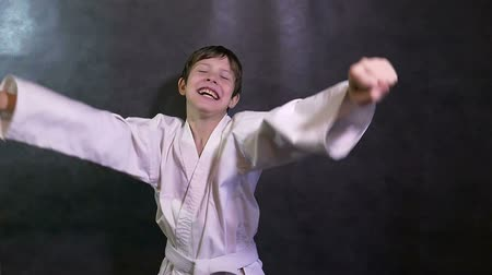quimono : Karate boy screaming kid success teenager victory rejoices slow motion