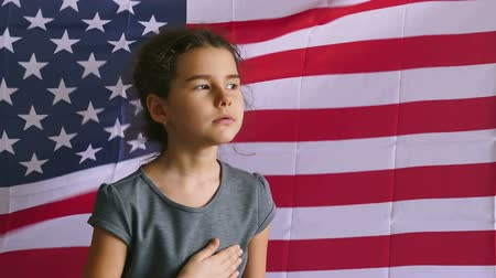 четверть : teen usa girl holding hands on the heart  Independence Day American flag Fourth of July