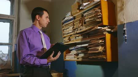 abacus : man accounting clerk retro touches the paper in an old office Stock Footage