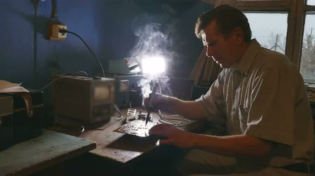 solder : old man technician radio solder iron retro soldering Stock Footage