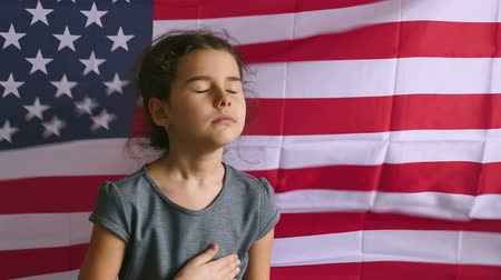 четверть : teen girl holding hands on the heart  Independence usa Day American flag Fourth of July
