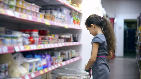йогурт : girl teen in supermarket to buy dairy food yogurt