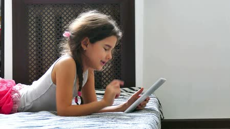 little : girl and tablet