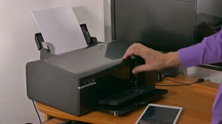 faks : man businessman in office prints documents on printer